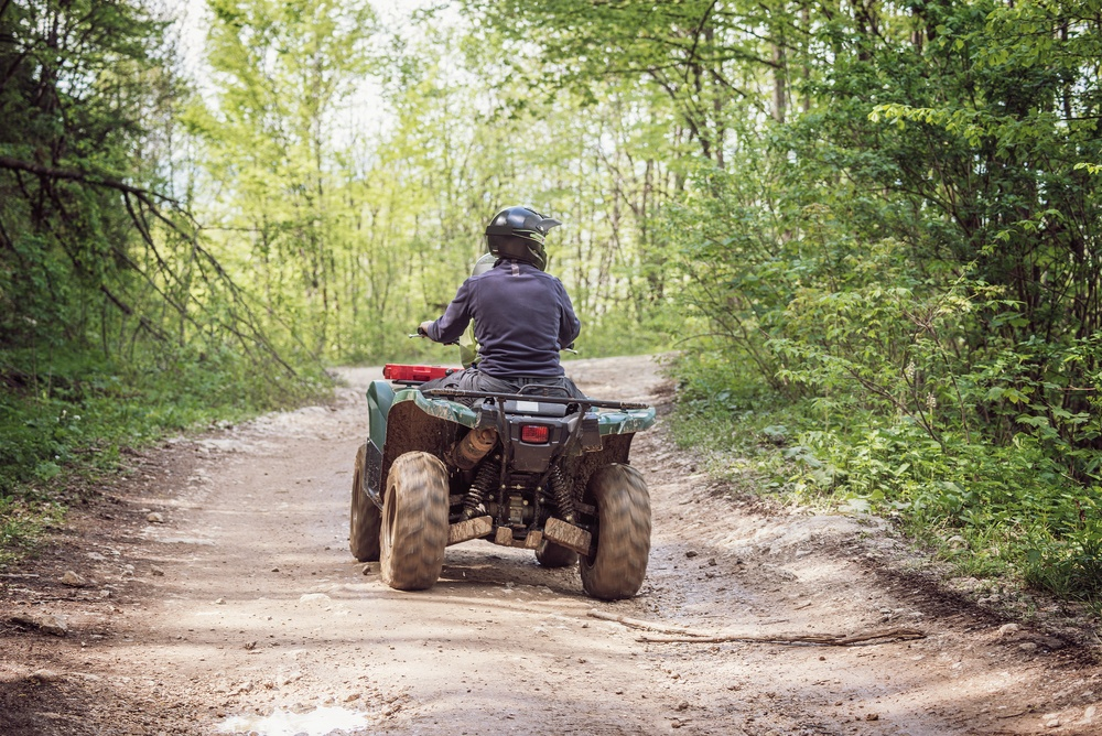ATV on dirt trail in the mountains