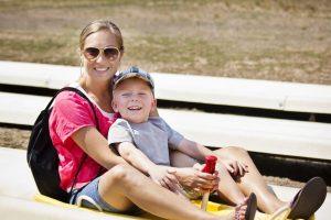 boy and mom enjoying a mountain coaster ride