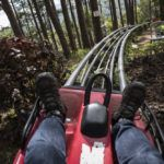 feet of a person in a mountain coaster